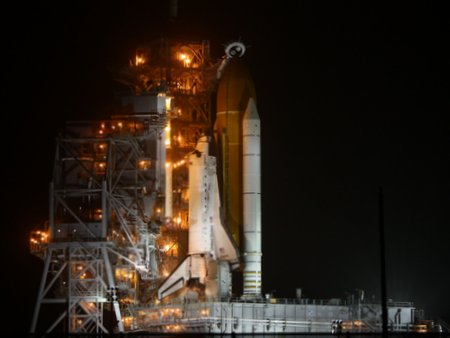 Discovery on pad 39A, night before her final launch